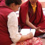 Student interviews a monk