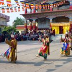 Locals in traditional dress perform a dance