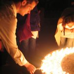 Students light candles at the temple