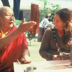 A student smiles as a Geshe talks expressively
