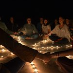 Students holdings hands in candlelit ceremony