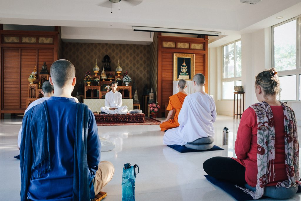 Students sit learning to meditate