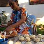 A member of a host family preparing local food