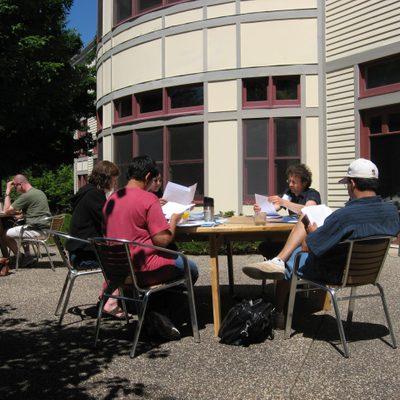 Portfolio readers in the sun.
