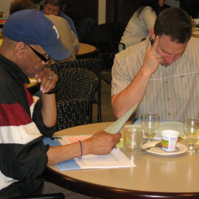 Carleton faculty members reading writing portfolios.