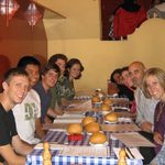 The group out to a meal with Spanish writer, Miguel Mena