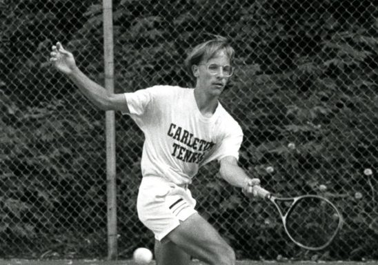 Carleton tennis player Tom James '89 returns the ball at a game during during 1987-1988.