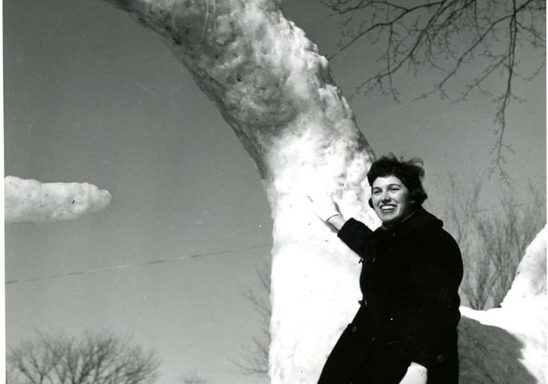 Knight and dragon snow sculpture, 1960. Student is Carole Pushing '61.