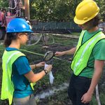 Student interns measuring samples