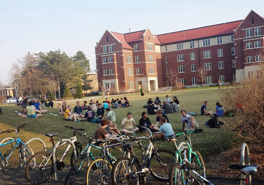 Students sit on the grass
