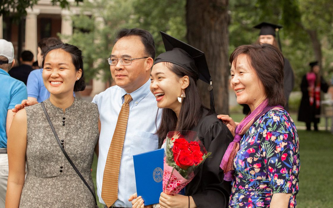 A graduate and her family at commencement