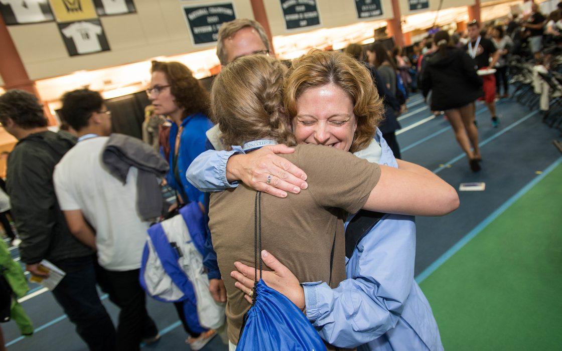 parents hug their student