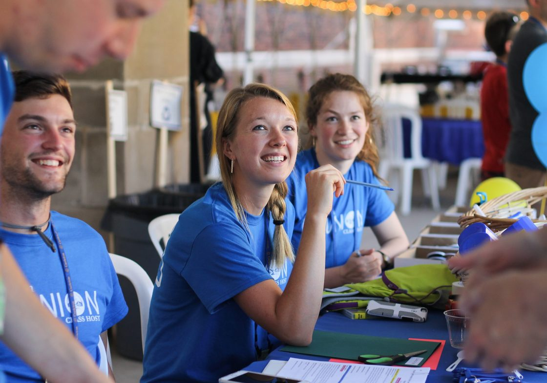 Student workers at a registration table