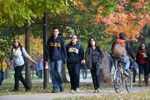 People walking and biking on campus
