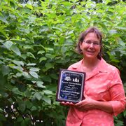 Arboretum director Nancy Braker with Carleton's 2015 Forest Stewardship Award