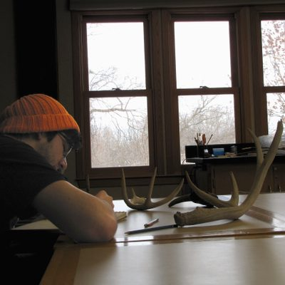 Cristian Castro '19 draws from the Arboretum Office's collection of antlers.