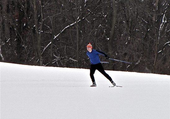Noah Carnahan '14 skate skiing in the Arb.