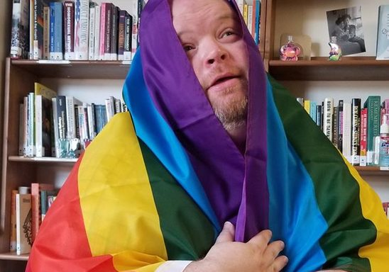 Danny Mathews with Rainbow Flag 2018