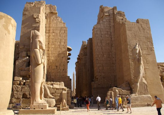 The great hypostyle hall at the Temple of Amun, Karnak. The obelisk of Hatshepsut in the distance.