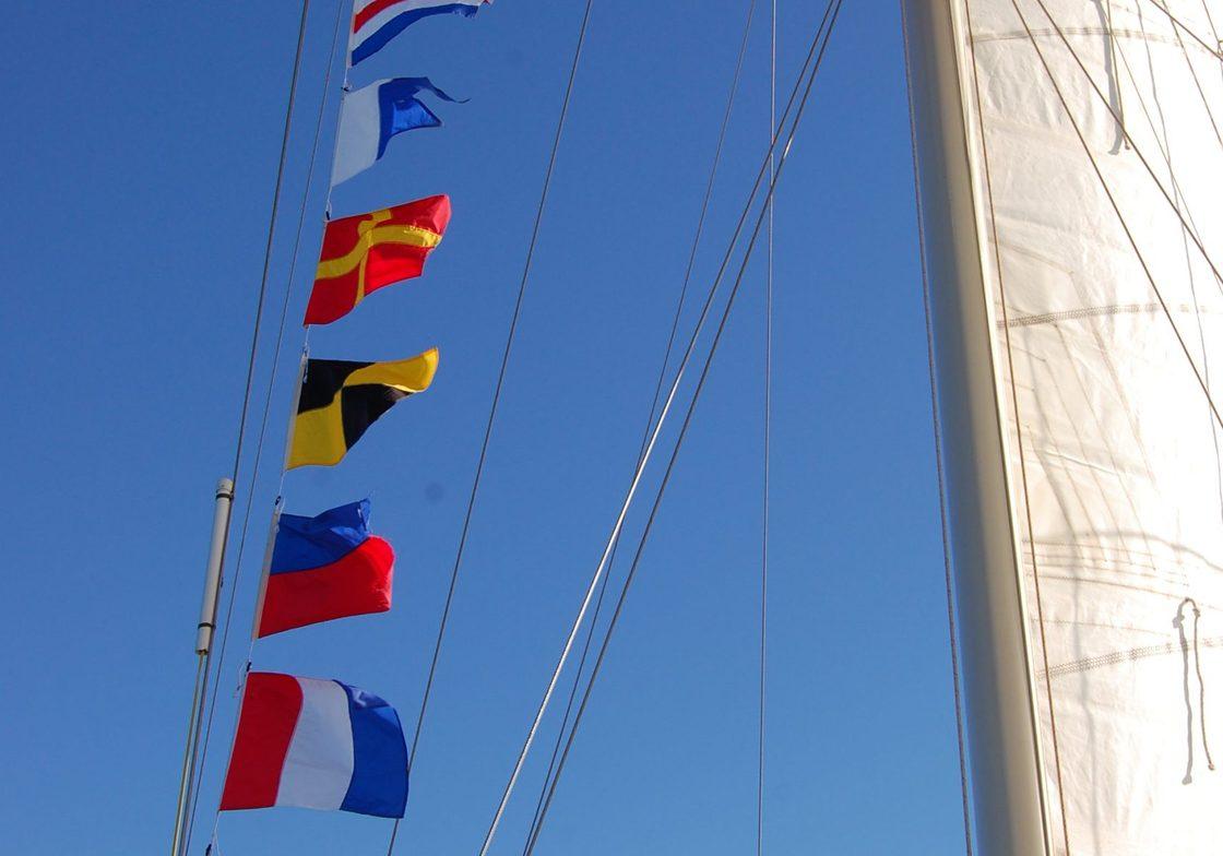 Baja Schooner flags on mast