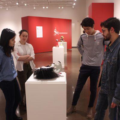 students looking at artworks