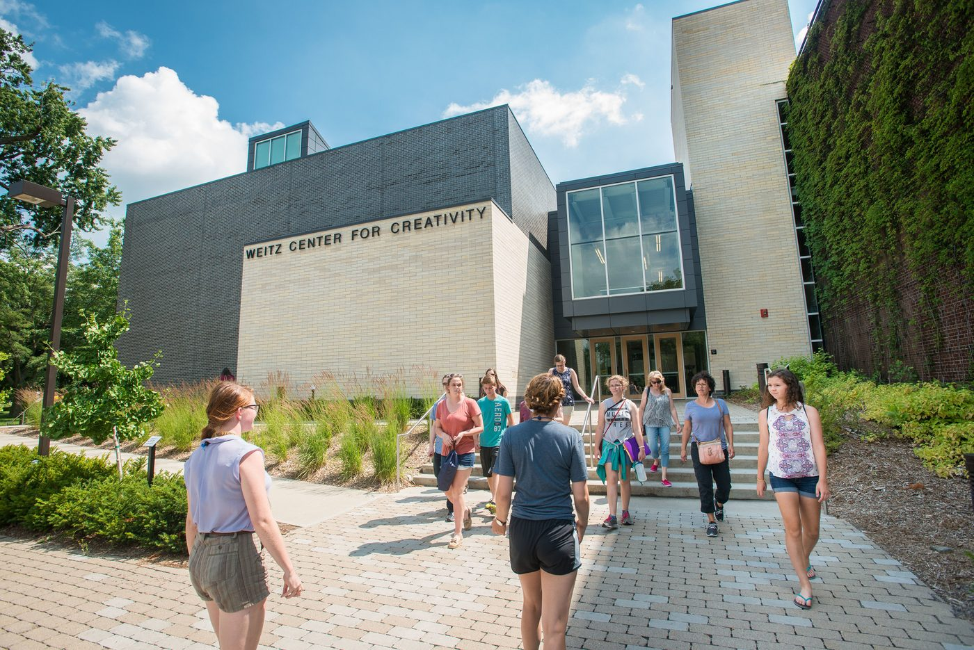 A group of people outside the Weitz Center for Creativity