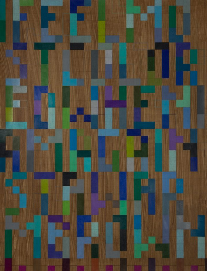 Geometric letters in different shades of green, blue, and purple
