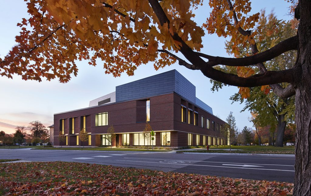 The exterior of the Music and Performance addition to the Weitz, with autumn leaves.