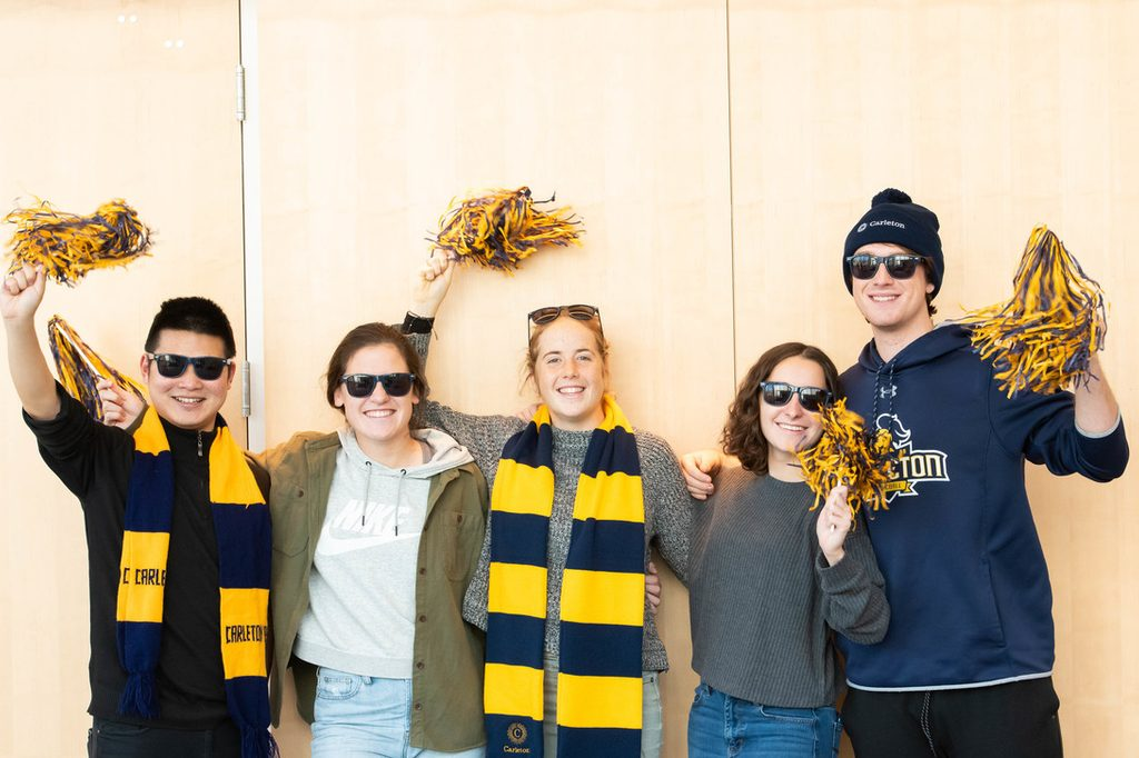 Students celebrate their bright future while wearing Carleton colors
