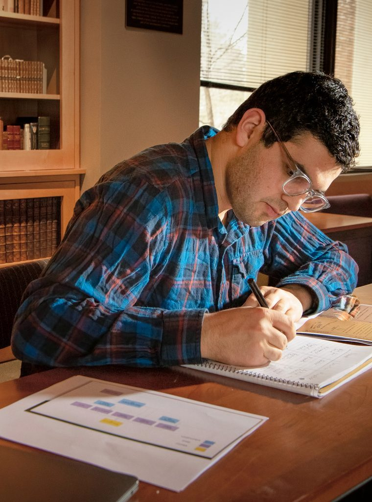 Aaron Forman '21 writing at his research fellowship