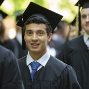 Smiling Carleton graduate at commencement