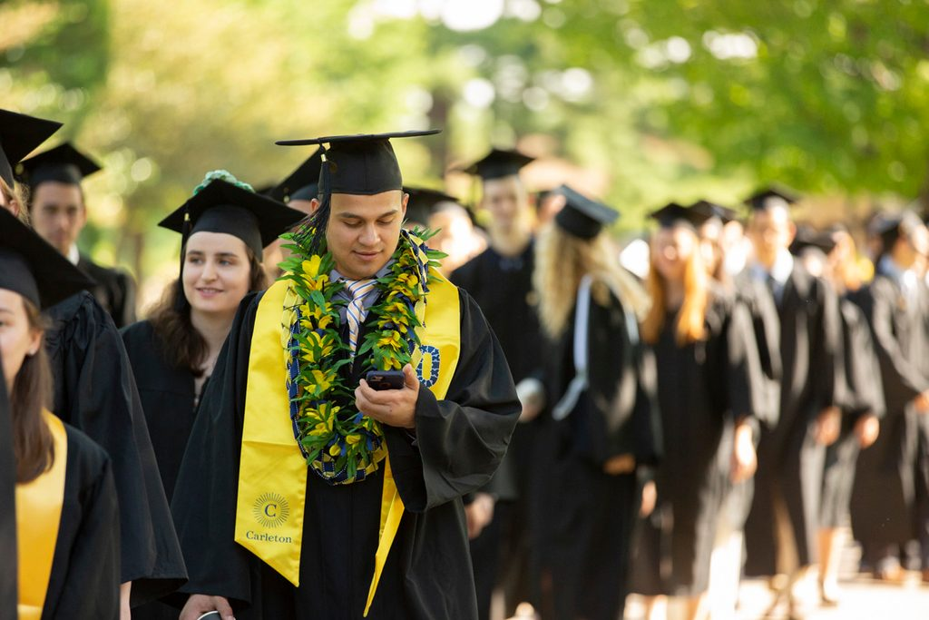 A long line of students at commencement