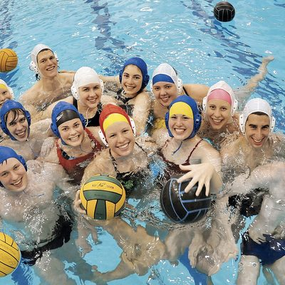 A group of water polo players in the pool
