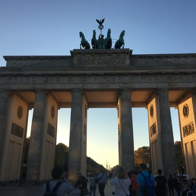 tourists photographing the Brandenburg Gate in Berlin, Germany
