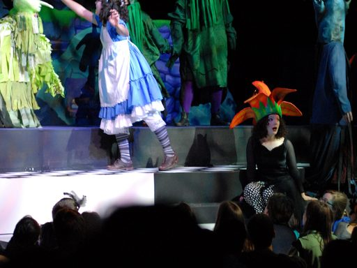 "Actors on stage during a performance of ""Alice in Wonderland"""