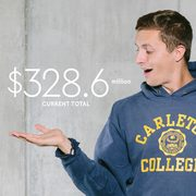 Photo illustration of a student with the campaign dollar amounts (current: $328.6 million, goal: $400 million) hovering above his hands