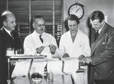 Scientists in suits and lab coats