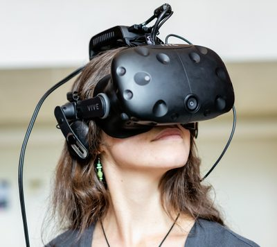 A young woman wearing a virtual-reality headset