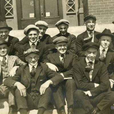 Students lounging on the front steps of Laird - 1920