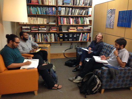 Professor Laska Jimsen meets with CAMS seniors developing comps proposals